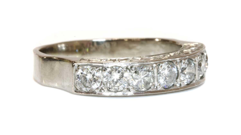 An 18ct white gold seven stone diamond half eternity ring,