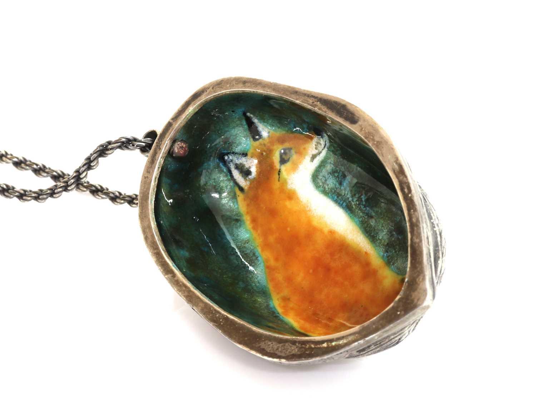 An enamel fox pendant, by Victor Lee,