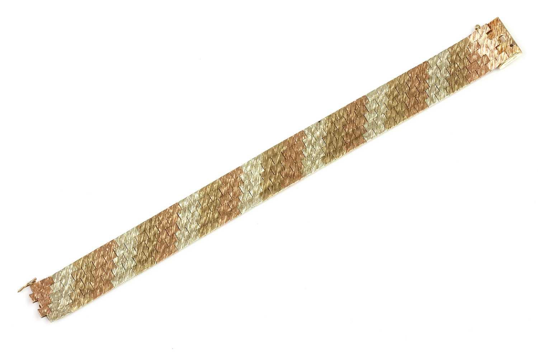 A 9ct three colour gold five row brick link bracelet, by Wristwear, c.1970,