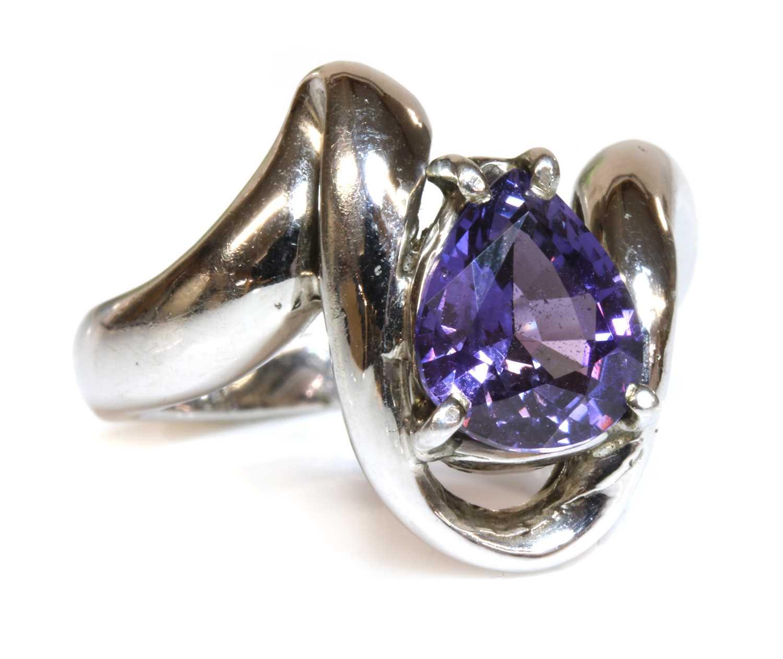 A 9ct white gold single stone purple sapphire ring,