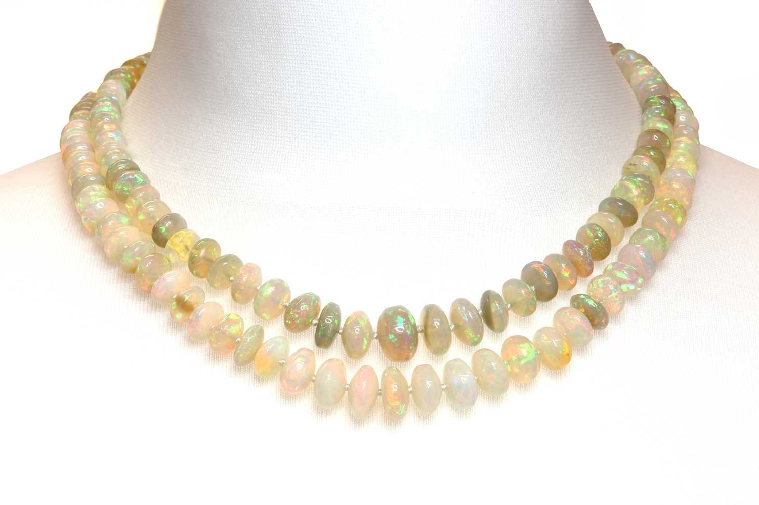 A two row graduated opal bead necklace,