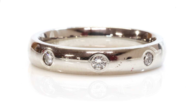 A diamond set wedding ring or gyspy band ring,
