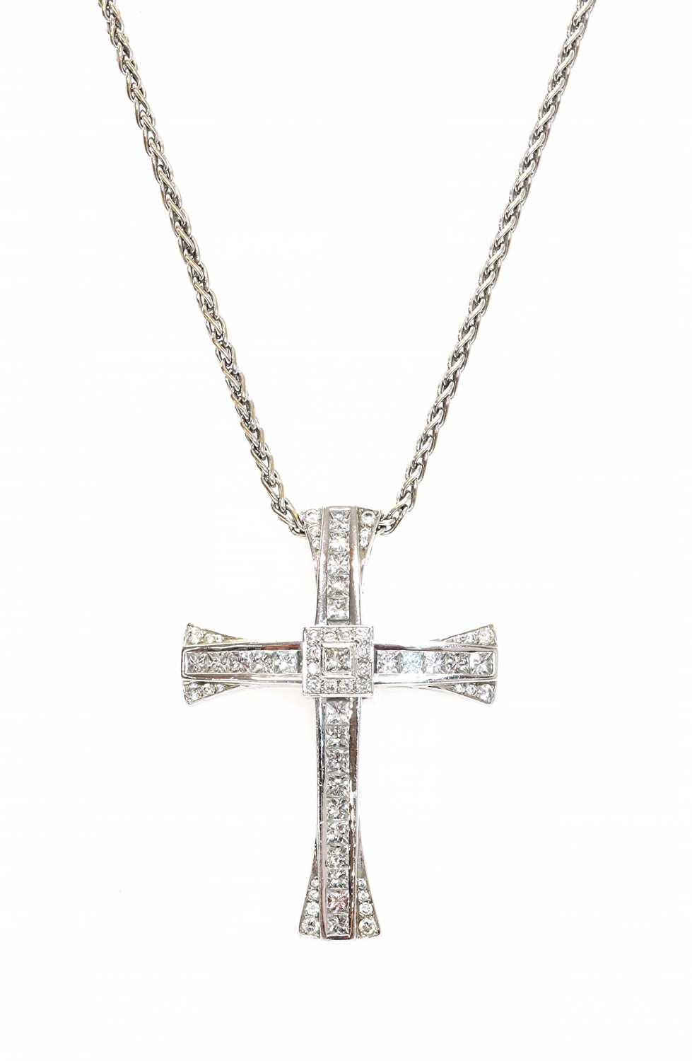 An 18ct white gold diamond set cross and chain,