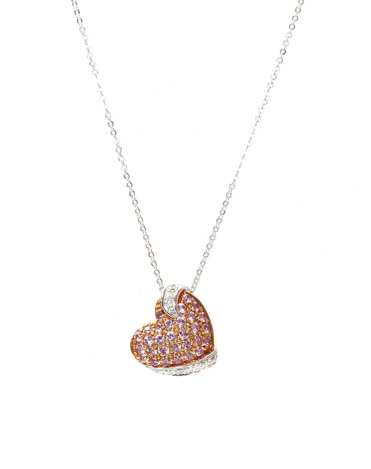 A pink sapphire and diamond heart pendant, retailed by Thurlow Champness,