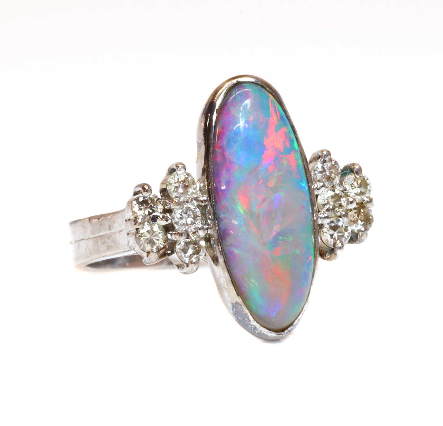 A white gold opal doublet and diamond ring,