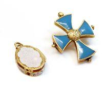 A miniature gold oval locket form vinaigrette,