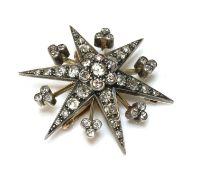 A late Victorian diamond set star brooch/pendant, c.1890,
