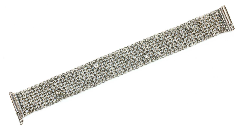 An 18ct white gold diamond set chain mail bracelet,