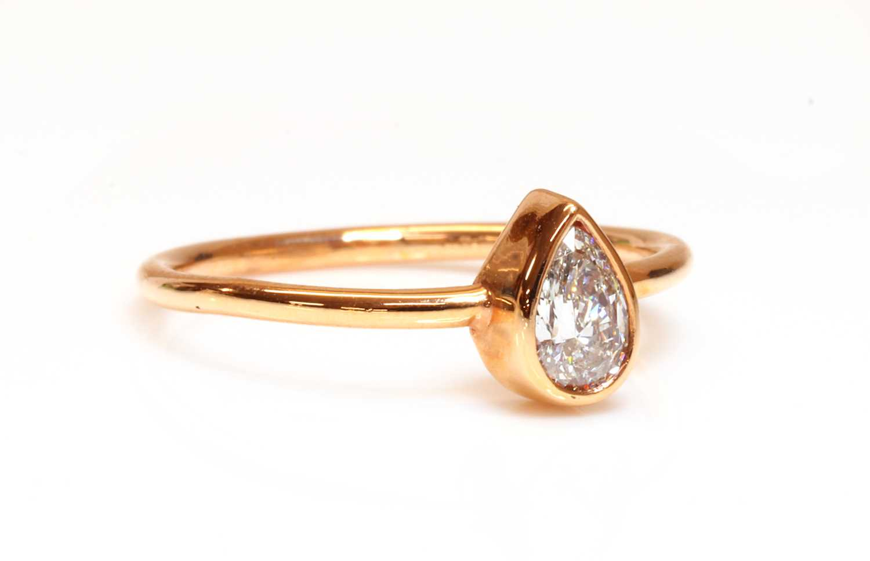 A rose gold single stone pear cut diamond ring,