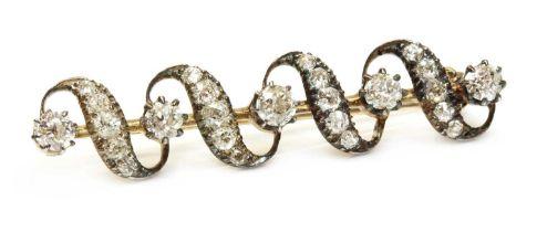 A late Victorian diamond set ribbon bar brooch, c.1880,