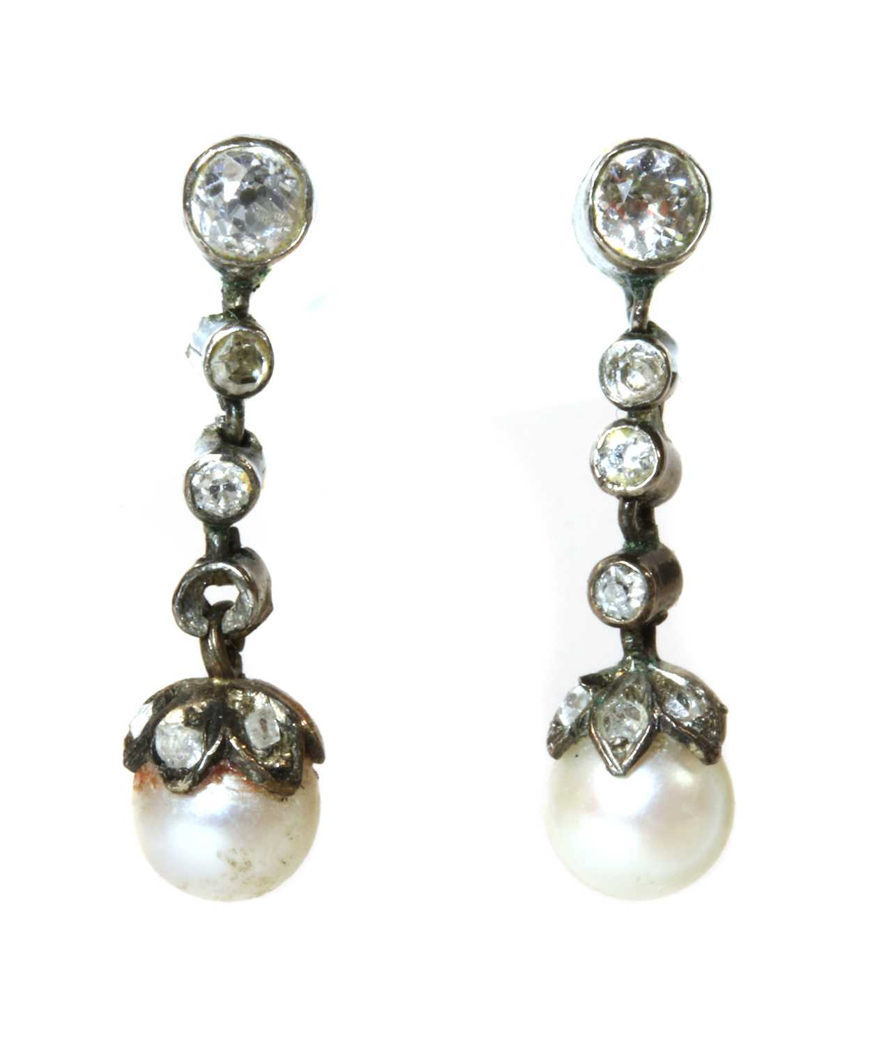 A cased pair of early 20th century pearl and diamond drop earrings,