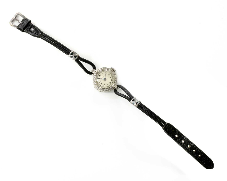 A ladies' 18ct white gold diamond set Vertex mechanical strap watch, c.1930,