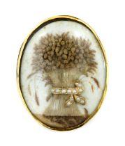 A Georgian split pearl memorial wheatsheaf glazed panel,