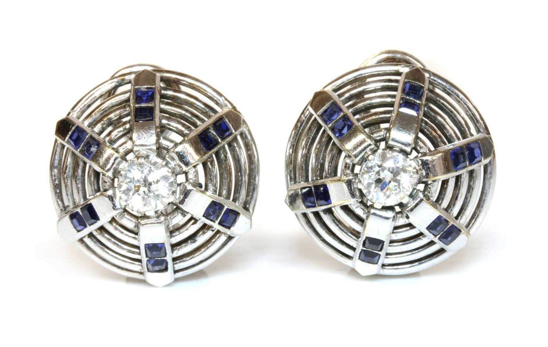 A pair of white gold diamond and synthetic sapphire bombé earrings, c.1940,