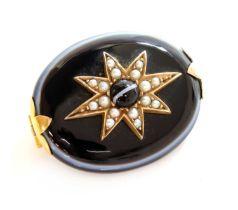 A Victorian bullseye agate and split pearl star brooch,