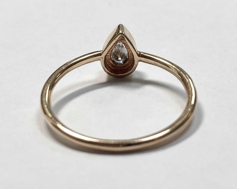 A rose gold single stone pear cut diamond ring, - Image 6 of 7