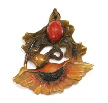 A French Art Nouveau carved horn pendant, by George Pierre, c.1910,