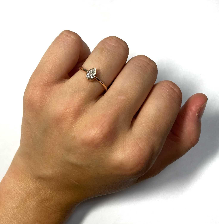 A rose gold single stone pear cut diamond ring, - Image 3 of 7