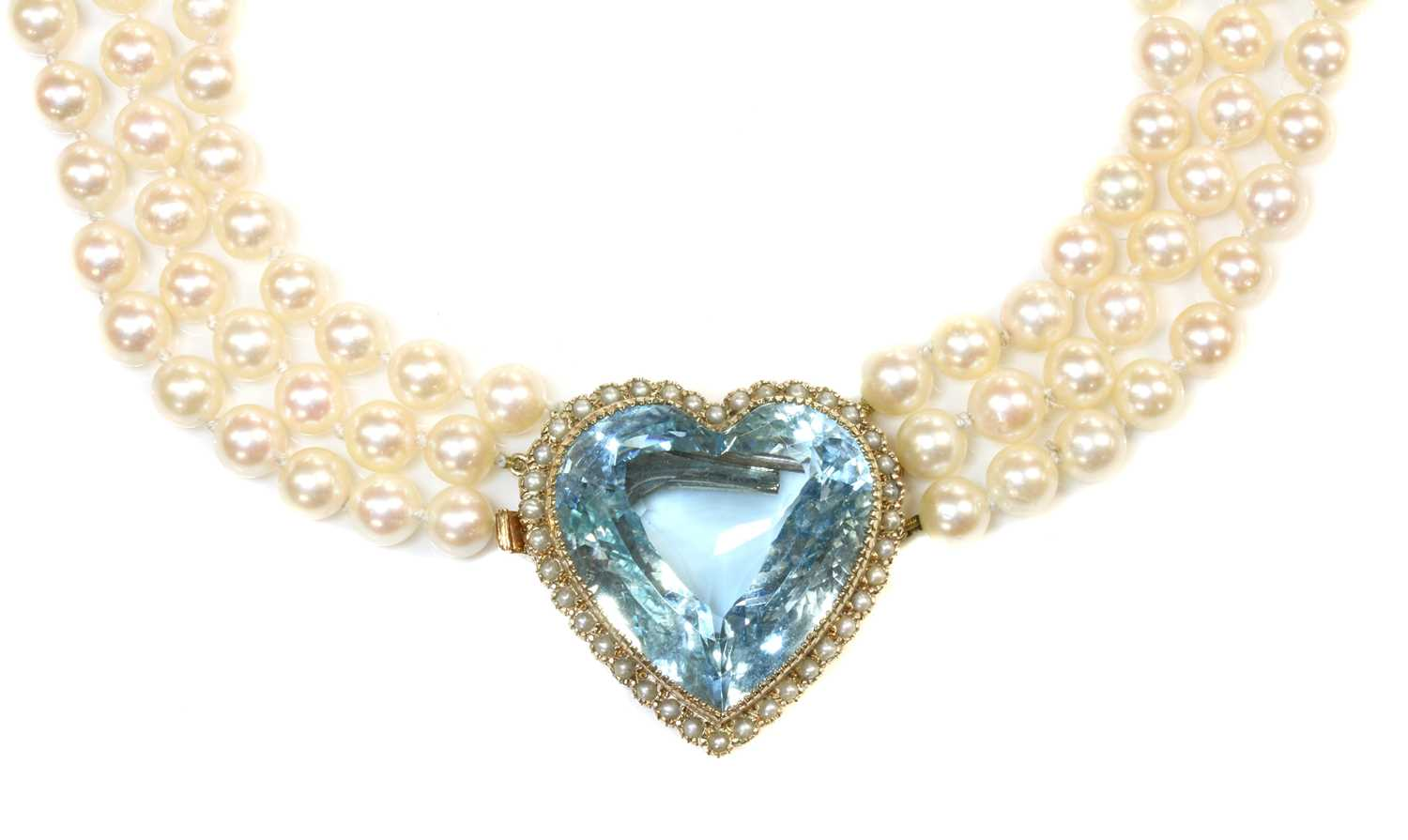 A three row cultured pearl necklace,