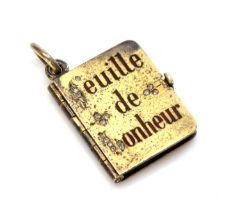 An Austrian gold diamond and enamel set book form locket, c.1900,