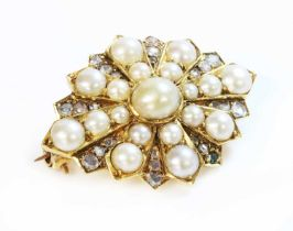 A Victorian gold split pearl and diamond star brooch or motif,