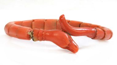 A late Victorian carved coral graduated snake bracelet, or semi flexible bangle,