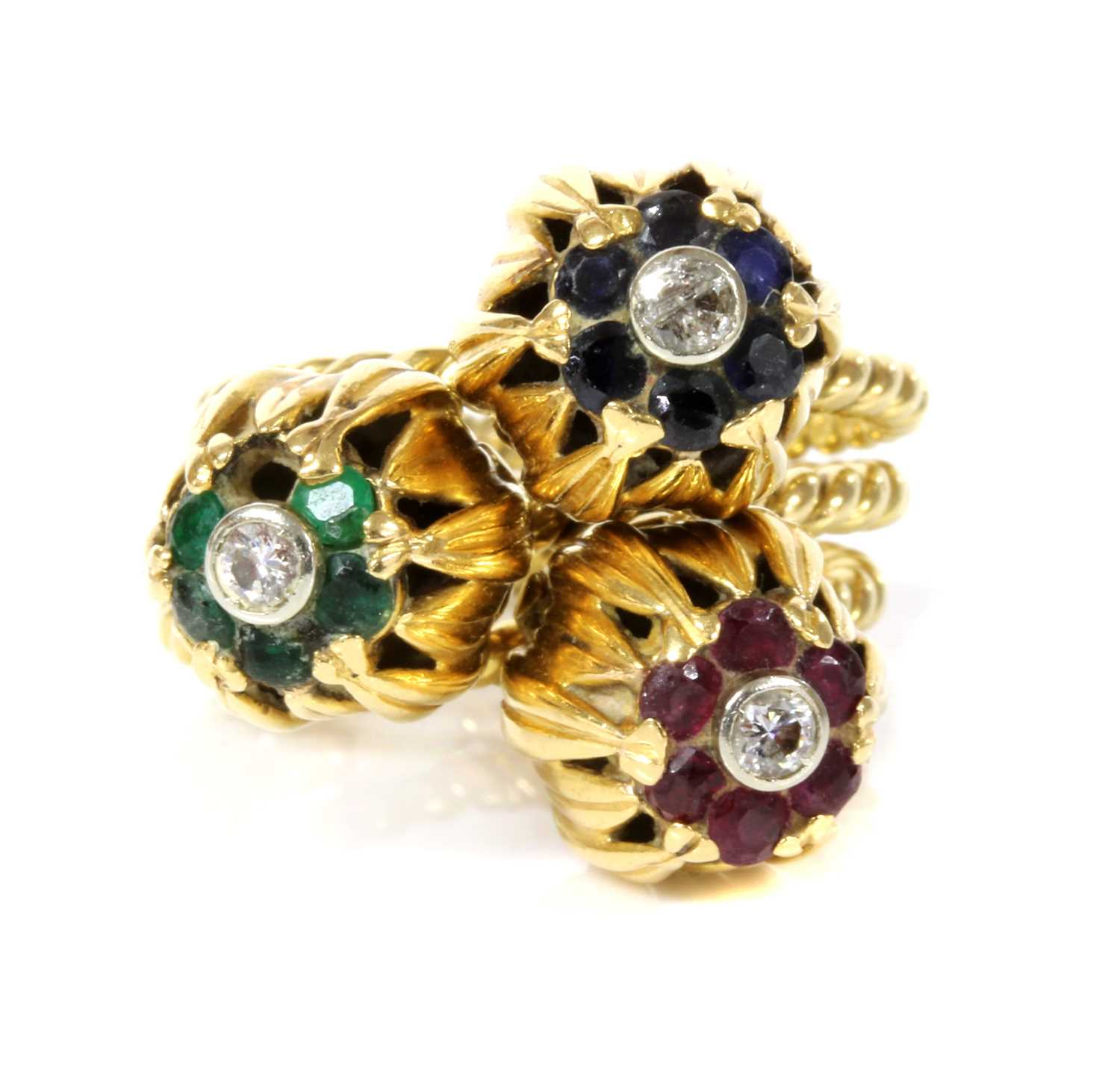 A set of three diamond and gem set stacking rings, c.1950,