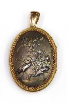 A Shakudo double sided oval hinged locket, c.1880,