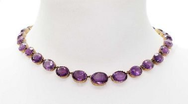 A late Victorian graduated amethyst rivière necklace,