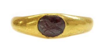 A Roman high carat gold garnet intaglio ring,