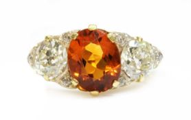 A late Victorian citrine and diamond boat shaped carved head ring,