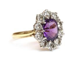 An 18ct gold amethyst and diamond cluster ring, by Arthur & Co., c.1970,