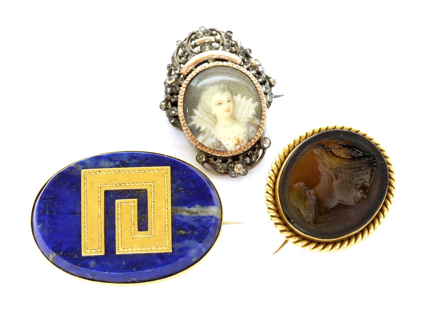 A late Victorian gold mounted Tassie intaglio brooch, by Benzie of Cowes,