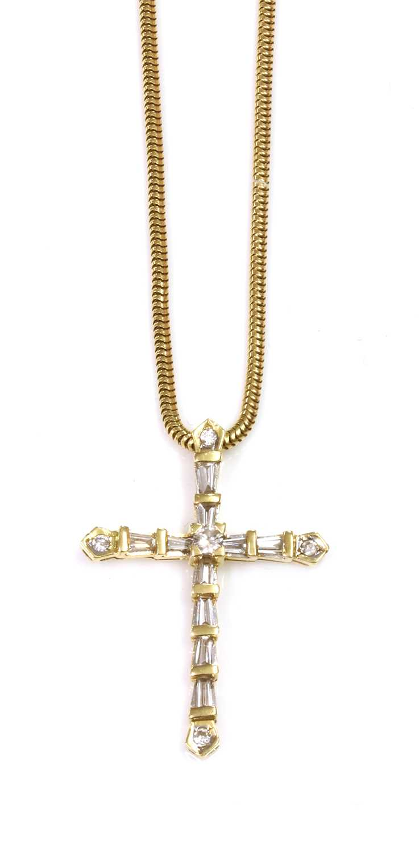 A Latin style diamond set cross and chain,