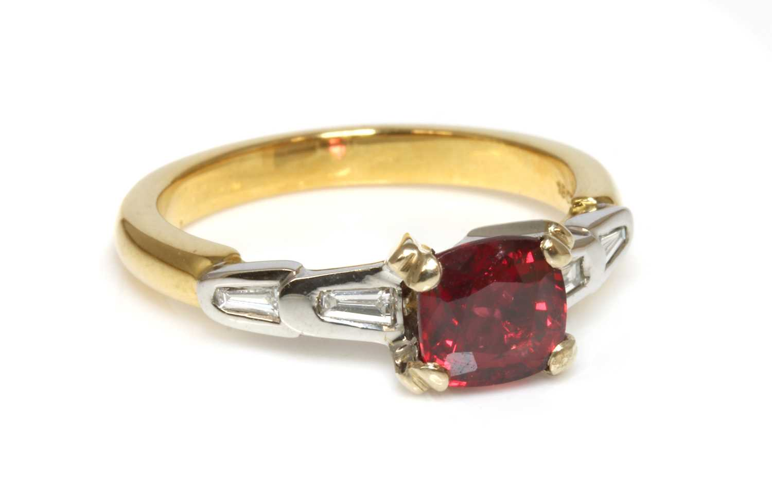 A two colour gold single stone red spinel ring,