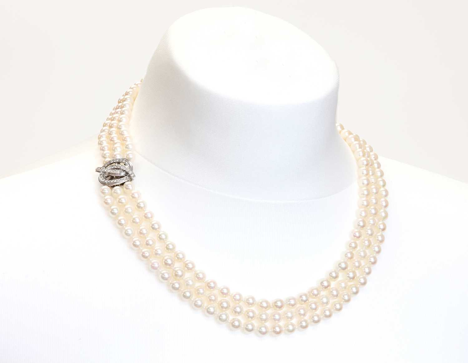 A three row cultured pearl necklace and bracelet suite, - Image 2 of 3