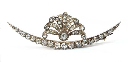 A late Victorian diamond set crescent and spray brooch, c.1890,