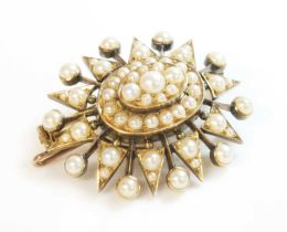 A Victorian gold split pearl oval starburst brooch/pendant, c.1900,