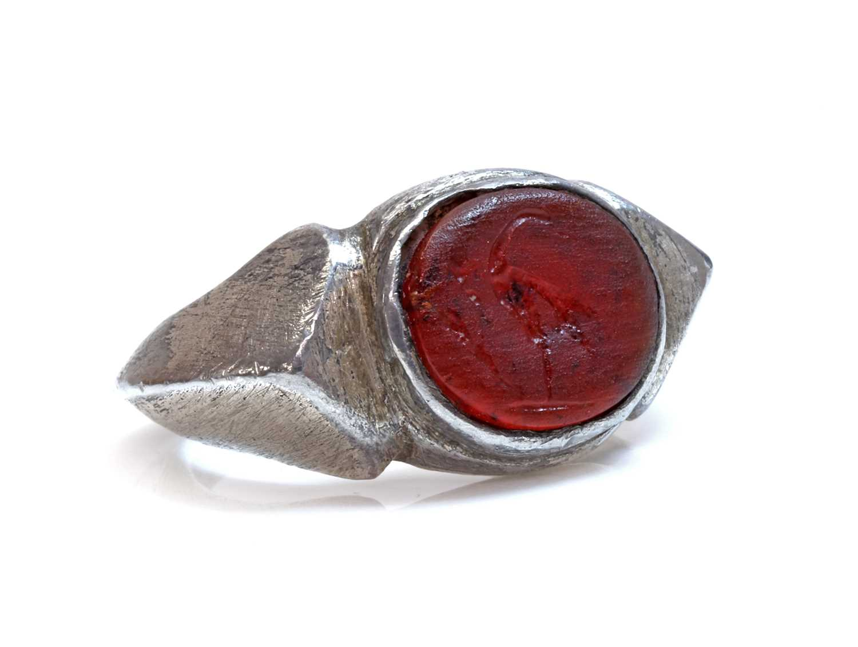 A Roman amber intaglio Legionnaires ring,