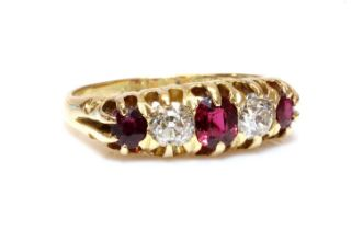 An 18ct gold red spinel, ruby and diamond boat shaped ring, c.1900,