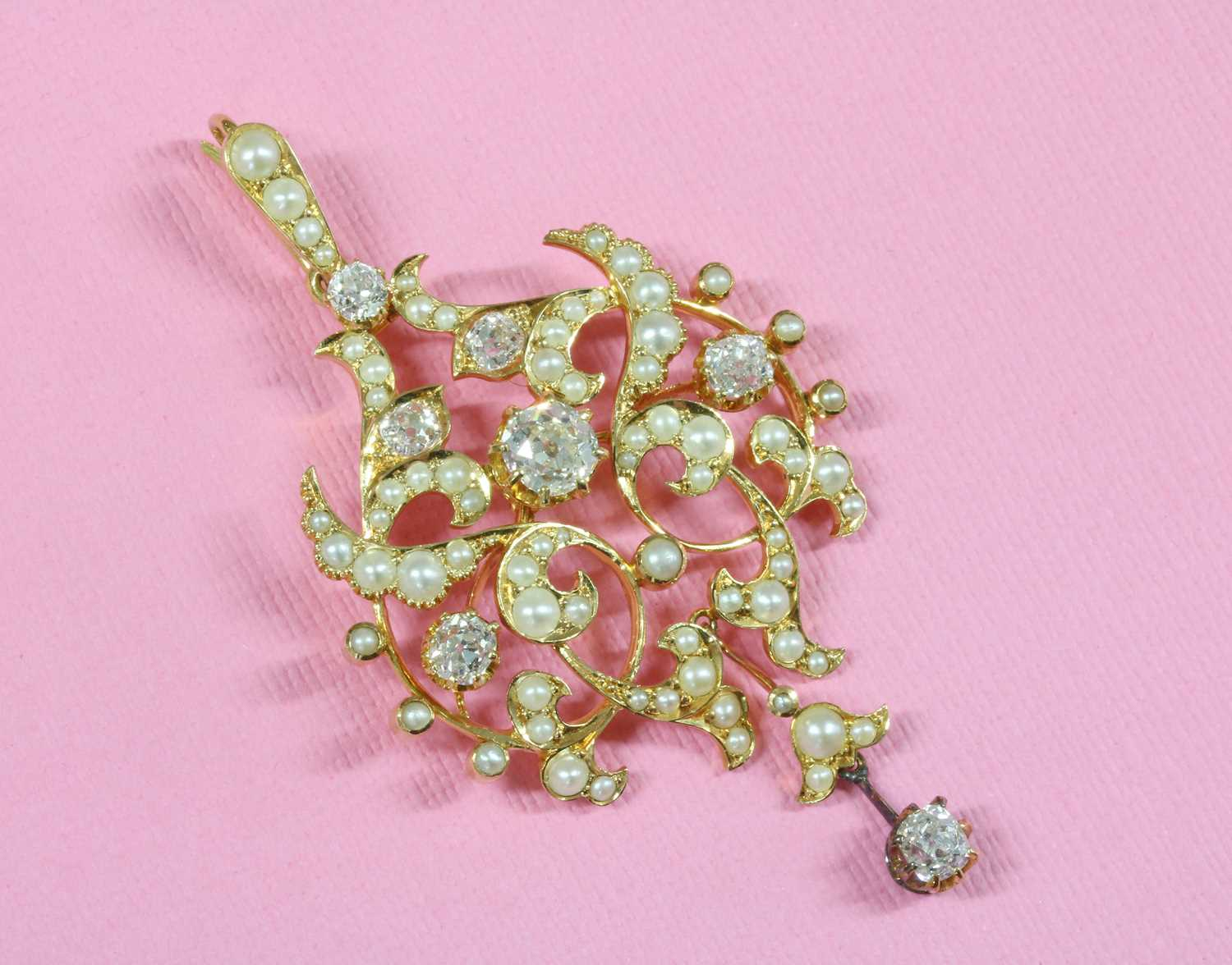 A late Victorian diamond and split pearl cartouche shaped brooch/pendant, c.1890, - Image 2 of 2