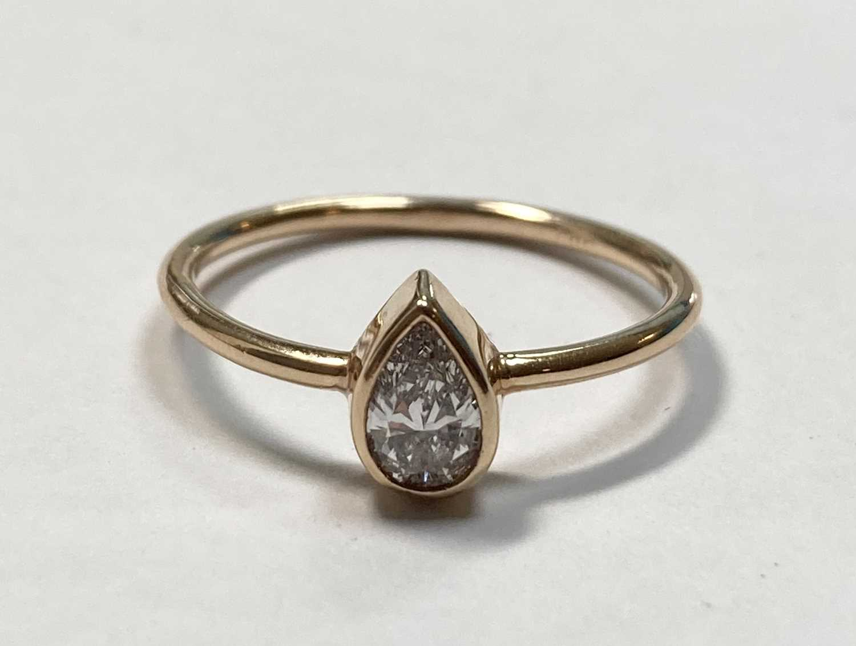 A rose gold single stone pear cut diamond ring, - Image 5 of 7