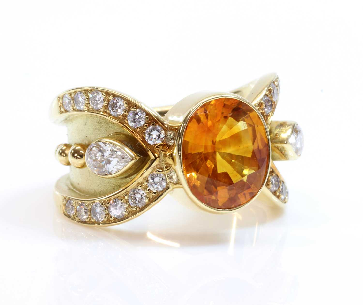A golden yellow sapphire and diamond band ring,