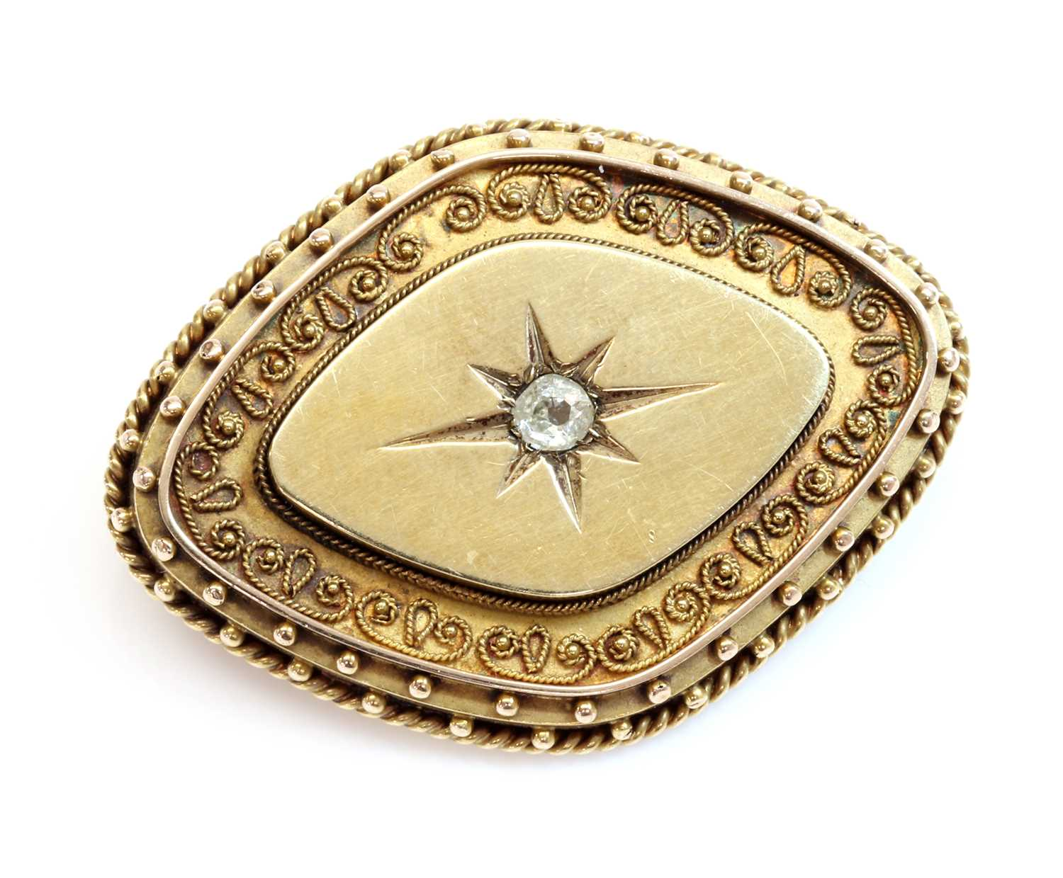A Victorian archaeological revival Etruscan style diamond set brooch, c.1870,
