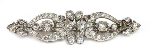 A diamond set bar brooch,
