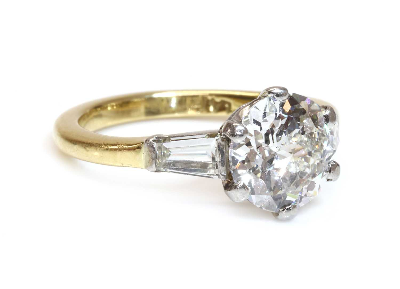 A single stone diamond ring with a jubilee crown cut diamond,