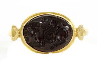 A Byzantine gentlemen's high carat gold cabochon garnet intaglio ring,