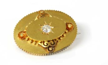 A Victorian gold diamond set oval shield form brooch, c.1870,