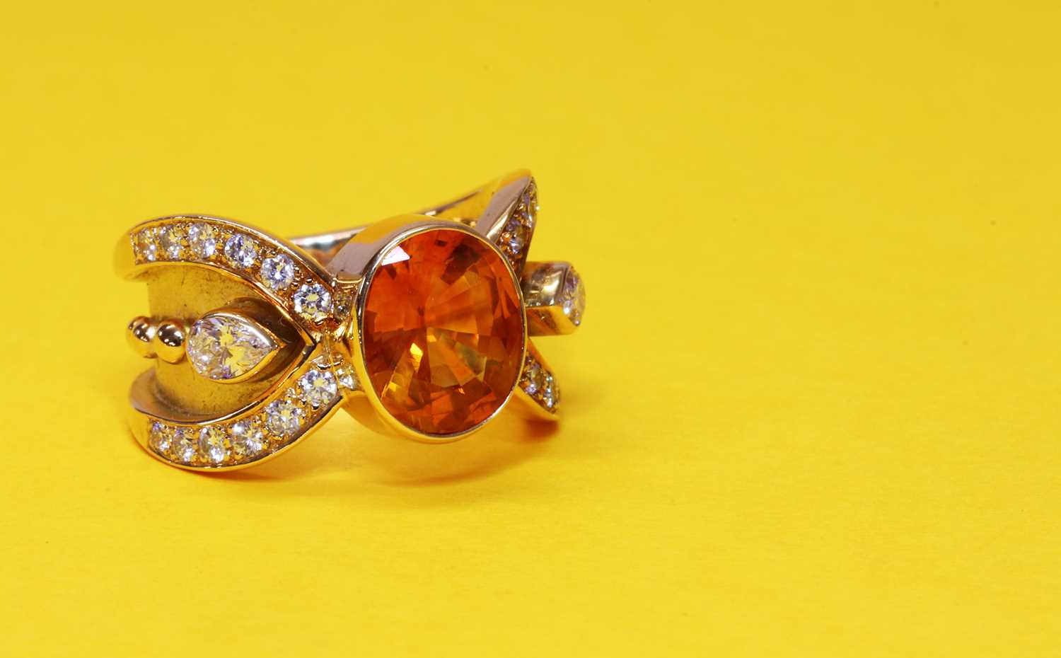 A golden yellow sapphire and diamond band ring, - Image 2 of 2