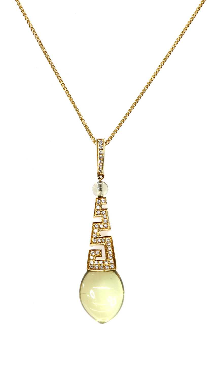 A gold citrine and diamond pendant,